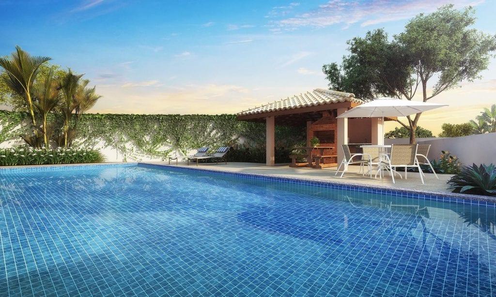 Perspectiva da piscina e quiosque com churrasqueira do Bella Vitta Residencial