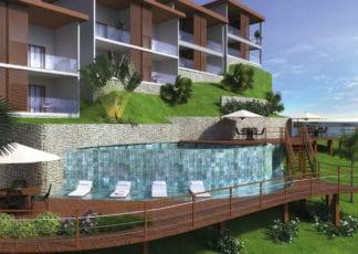 Perspectiva da piscina com cascata e deck