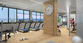 Perspectiva da academia de ginástica com vista mar do JAGUAH Residence