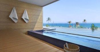 Perspectiva da sauna com acesso à piscina