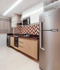 Foto da cozinha do apartamento decorado.