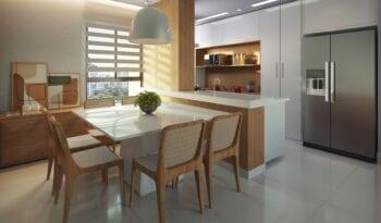 Perspectiva da sala de jantar e cozinha integrada do Dumare.