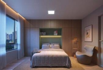 Perspectiva do quarto do casal da planta de 02 suites com decoração Family Versatile do LIFE Imbuí.